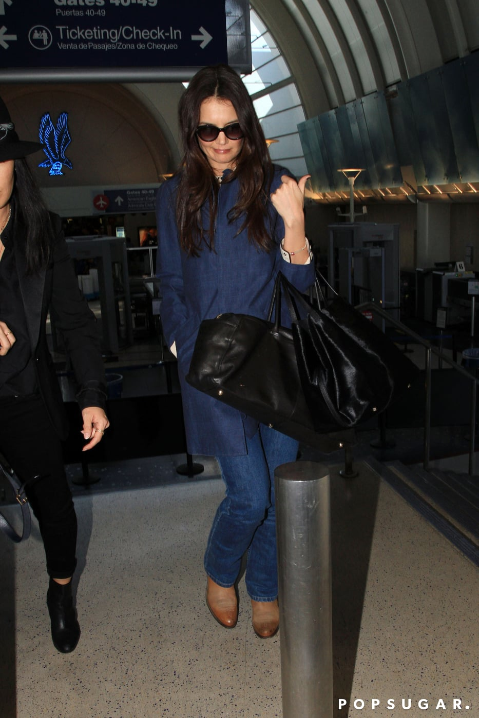 Katie Holmes Touches Down With Her Holmes & Yang Business Partner