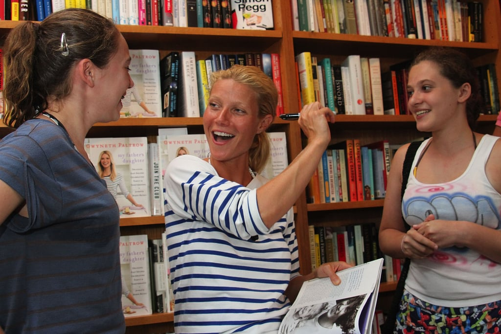 Gwyneth happily signed autographed copies for fans.