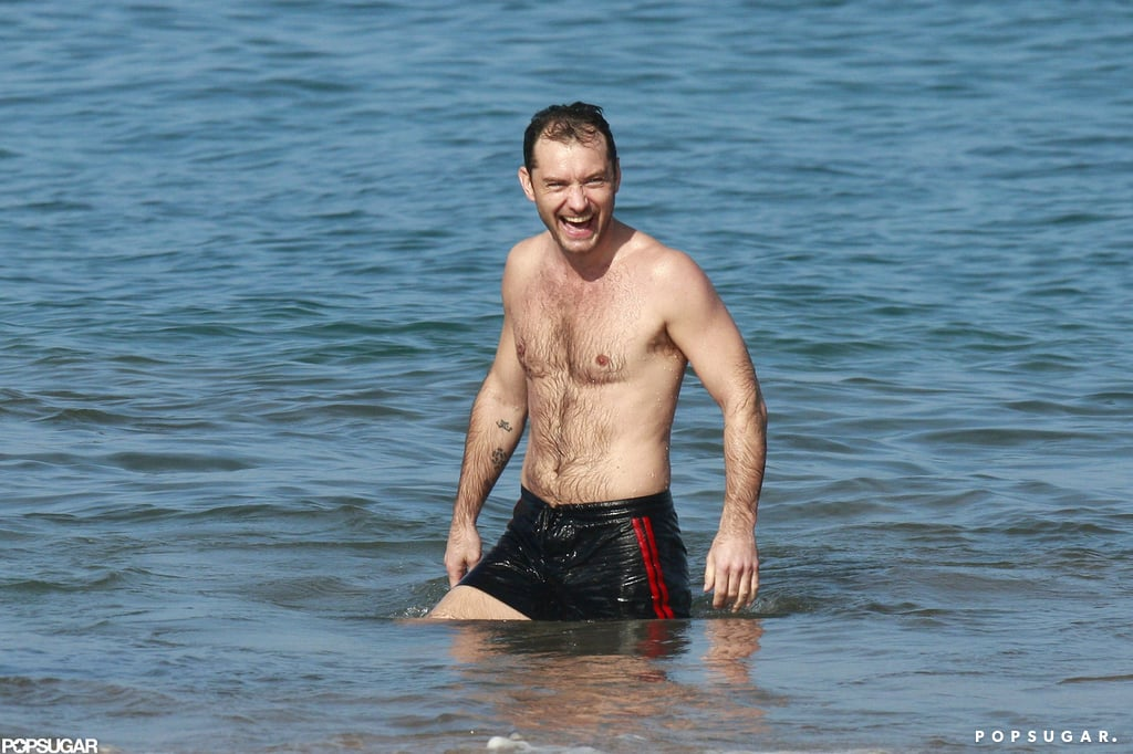 Jude Law waded in the waves.