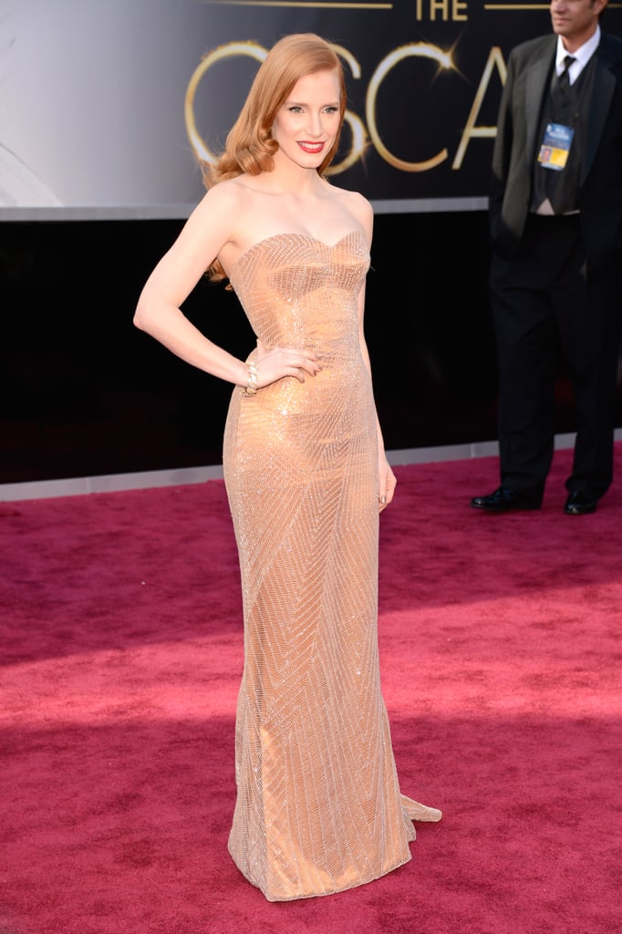 Jessica Chastain paired her custom Armani gown with bright red lips for the Oscars.