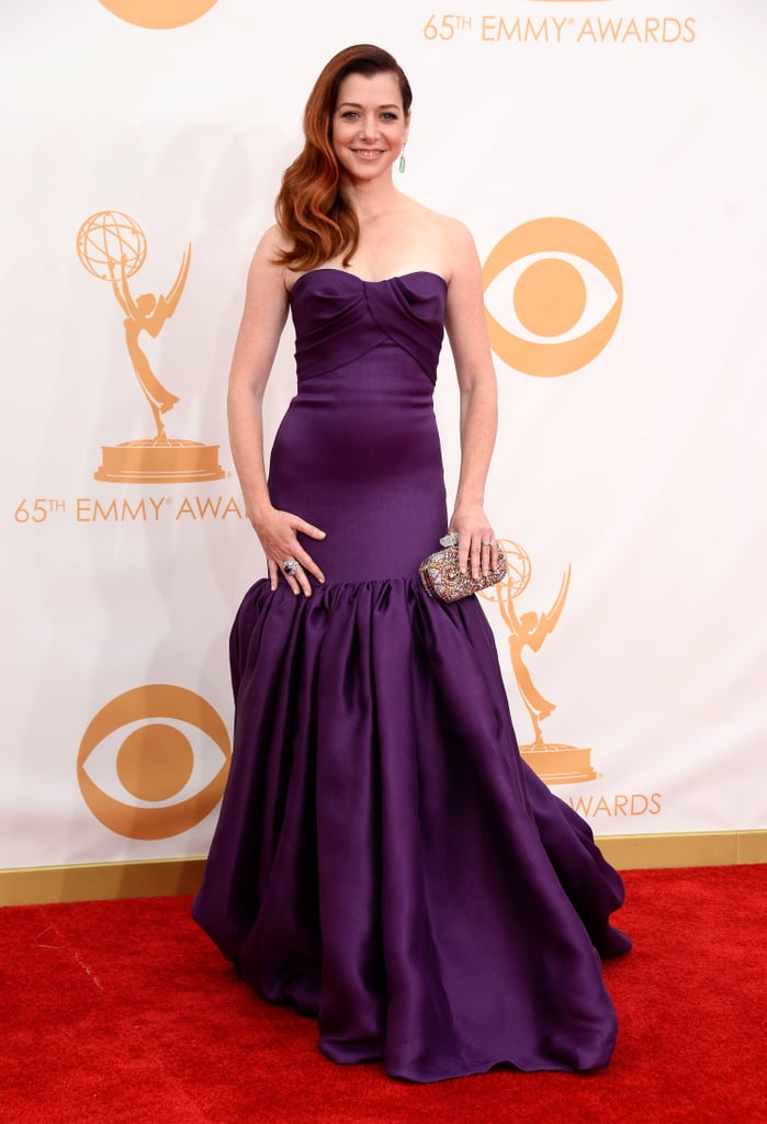 Alyson Hannigan looked glamorous in a rich strapless purple Marchesa dress. She carried a Marchesa clutch, too.