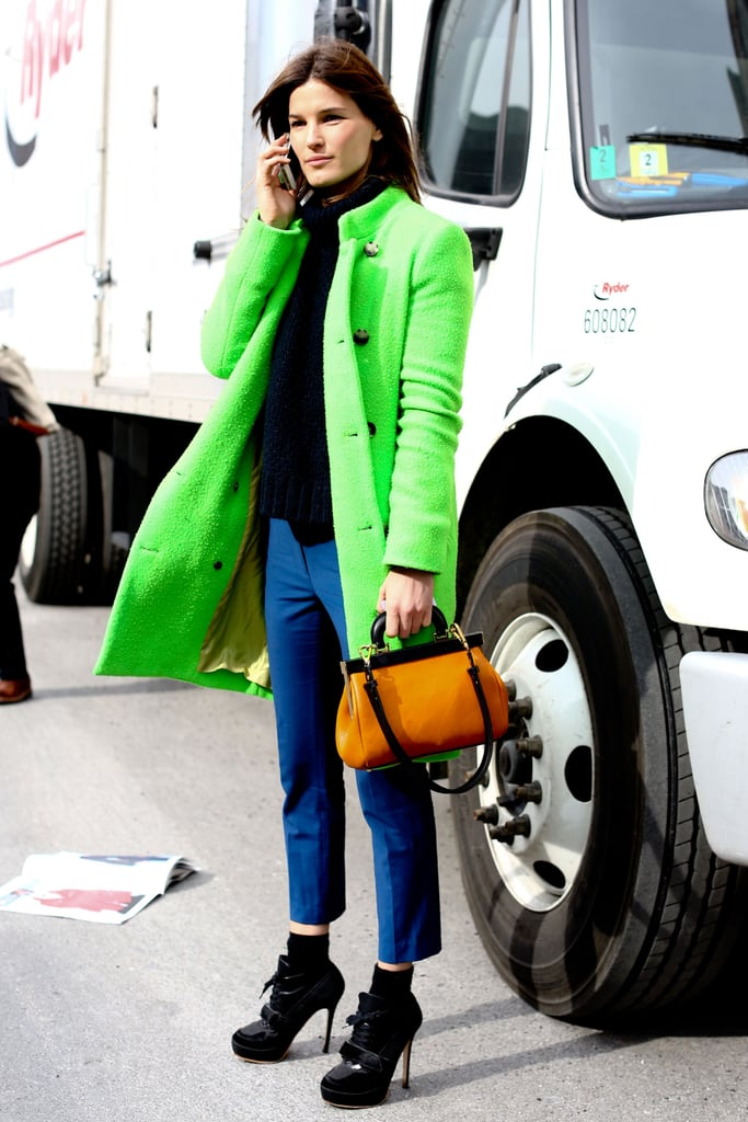 Hanneli Mustaparta injected a hot lime-green hue on her coat, spotlighting an otherwise understated ensemble.