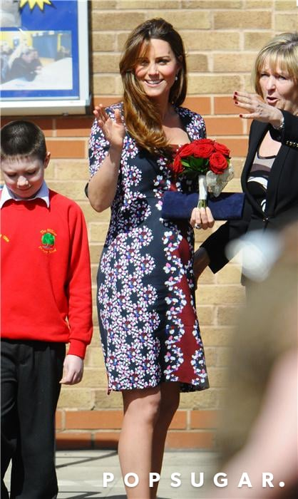 Kate Middleton held onto a bouquet of red roses.