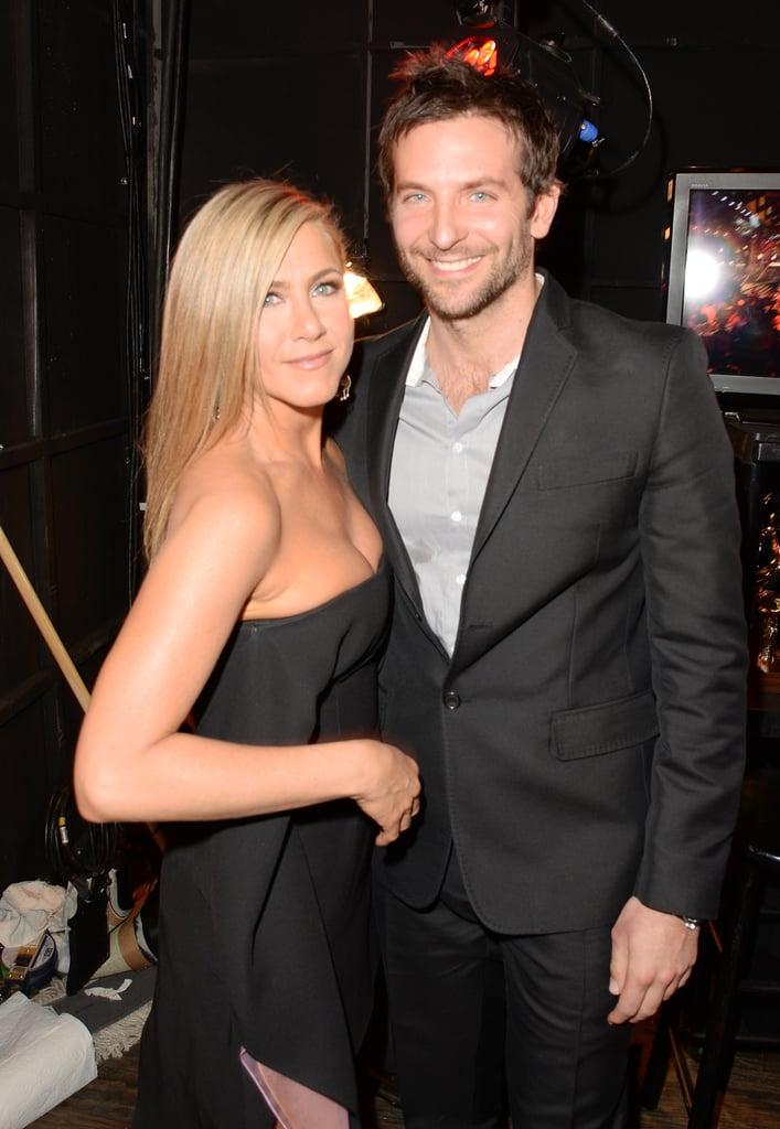 Jennifer Aniston and Bradley Cooper posed together backstage.