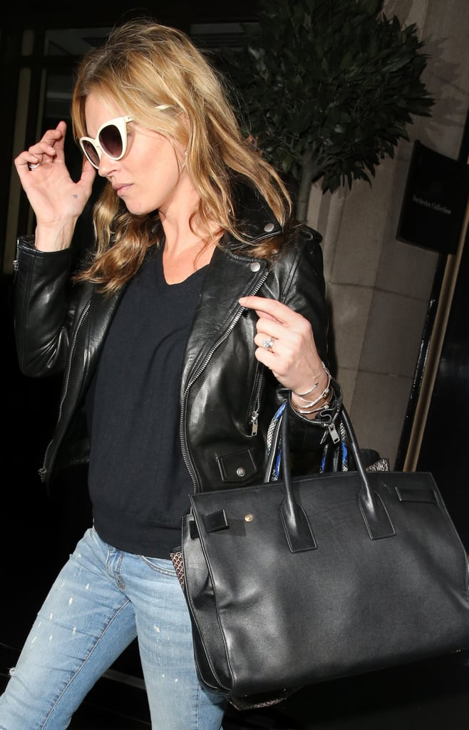 Couldn't believe a bag so elegant would work for the edgier set? Kate Moss proves it by mixing the style with distressed jeans and a leather jacket. Photo courtesy of Saint Laurent