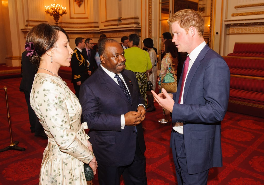Prince Harry spoke with President Ali Bongo Ondimba of Gabon and his wife, Sylvia, at the Buckingham Palace reception for heads of state attending the Olympics.