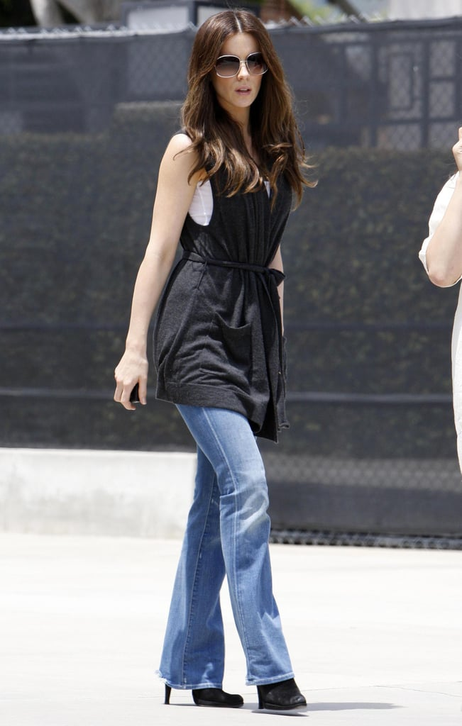 A sleeveless wrap cardigan, light-wash flared denim, and suede booties rounded out Kate's Beverly Hills ensemble in 2008.