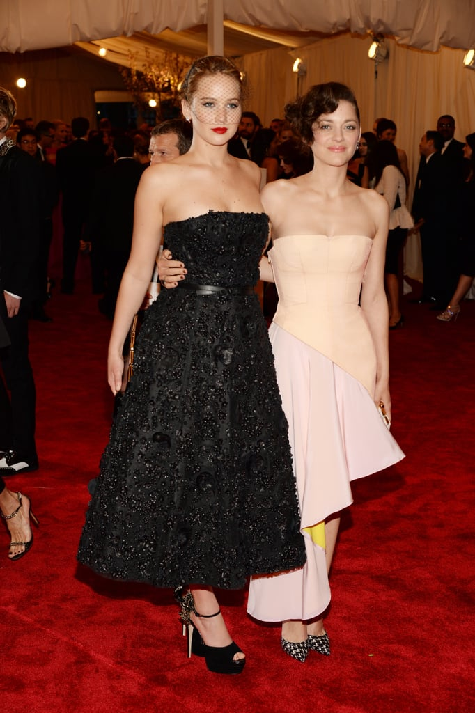 Marion Cotillard and Jennifer Lawrence at the Met Gala 2013.