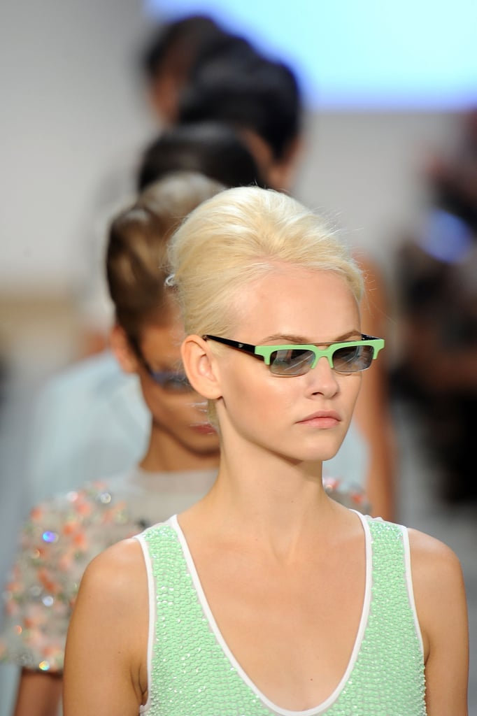 And now we have the beehives! For Spring 2012, the models at the Diane von Furstenberg show sported minibeehives with neat french rolls.
