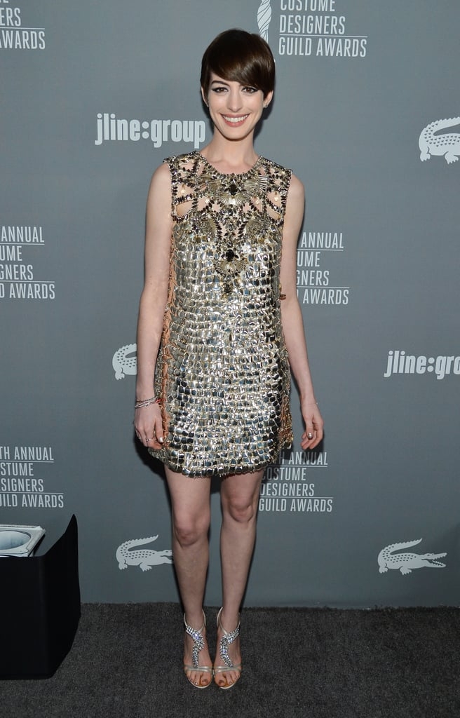 Anne Hathaway tapped into her glam side in a gold metallic Gucci minidress and equally shiny rhinestone sandals.