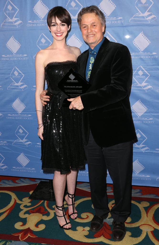 Anne Hathaway joined Jonathan Demme on the carpet.