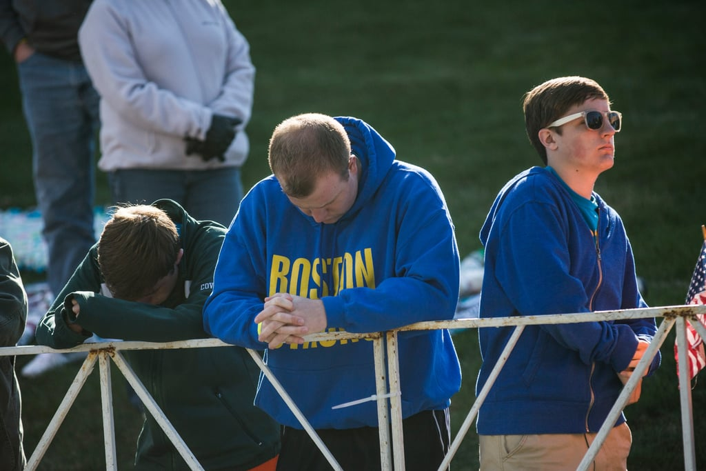 People bowed their heads for a moment of silence ahead of the race.