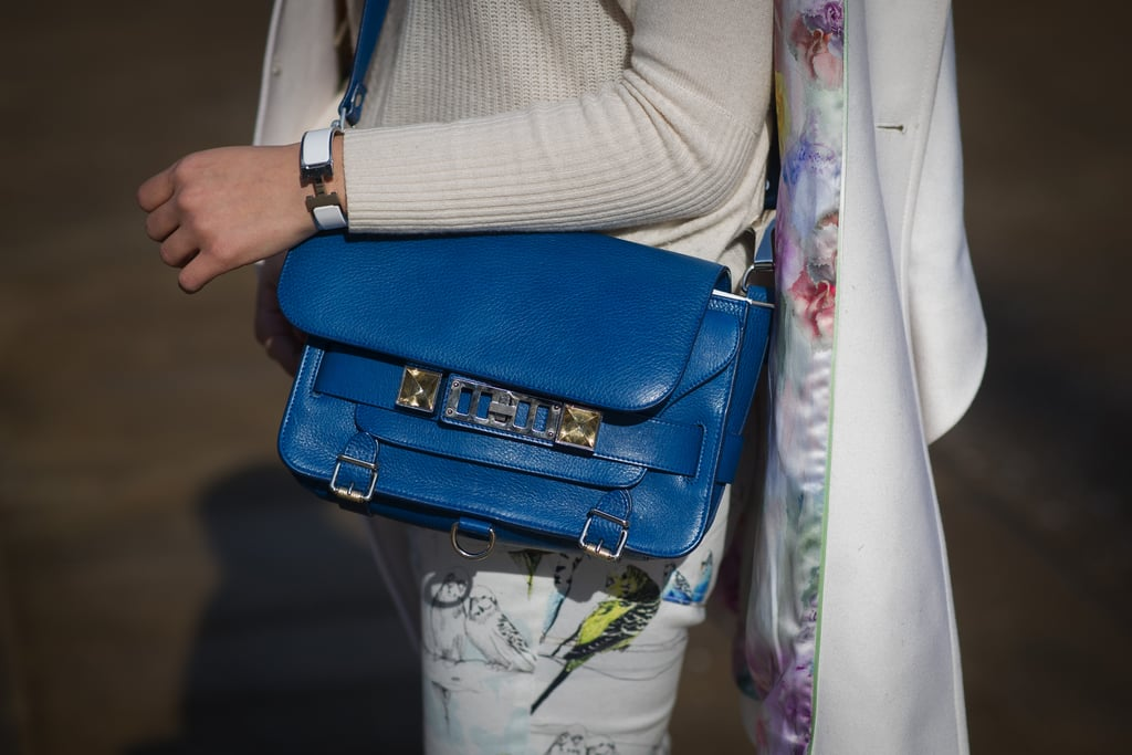 A pretty blue Proenza bag and floral denim hinted at Spring.