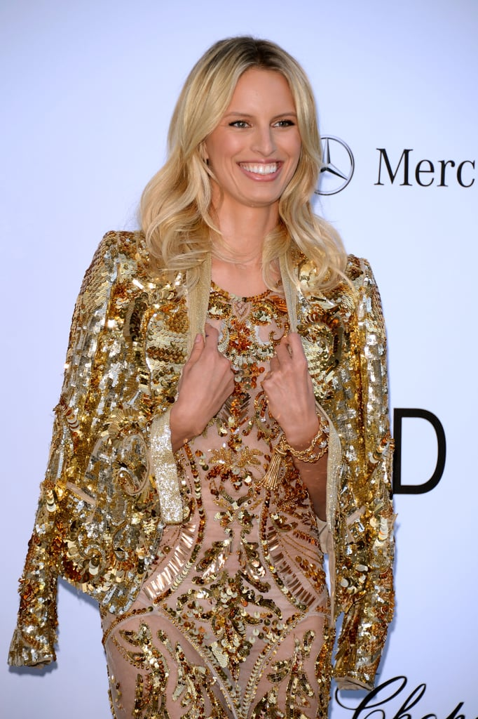 To polish off her look, Karolina kept her metallic gold Roberto Cavalli blazer draped at her shoulders.