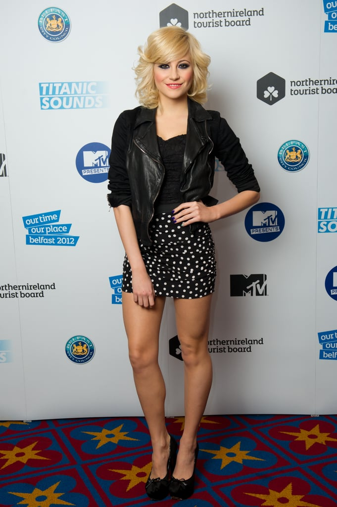 Pixie Lott paired her high-waisted polka-dot mini with a black bustier top, leather jacket, and bow-tied pumps.