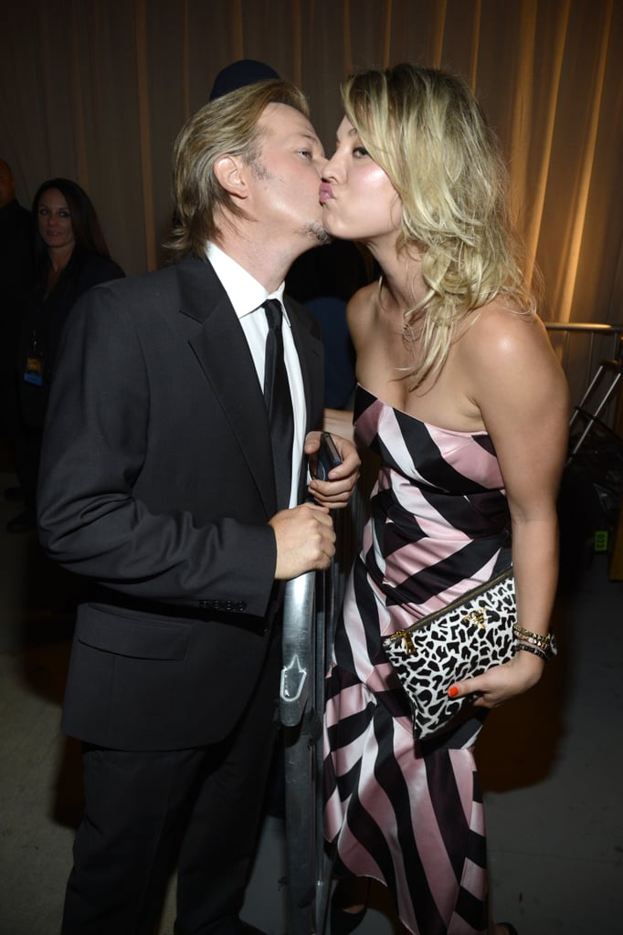 Kaley Cuoco and David Spade shared this kiss in 2013.