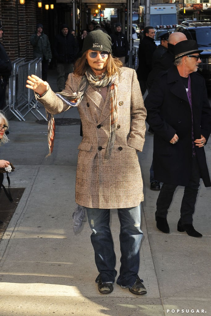 Johnny Depp wore a plaid overcoat and black cap to stop by the Late Show in NYC.