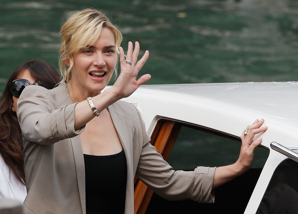 Kate Winslet waves to fans in Venice.