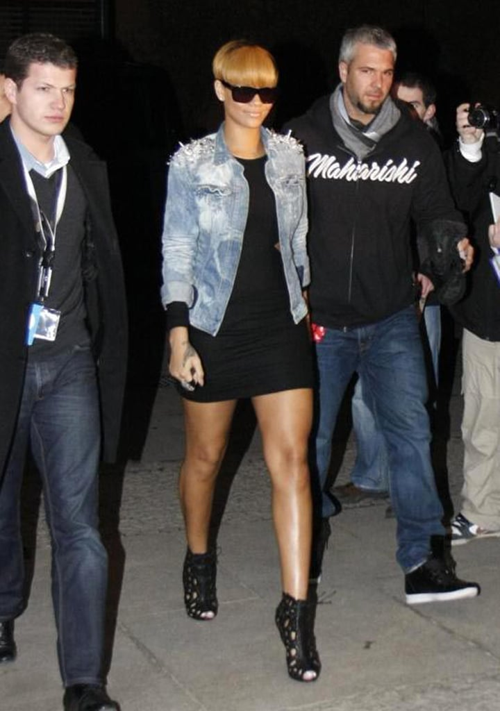 In 2010, the singer landed in Germany for an autograph signing wearing a cutout LBD with a distressed spiked Blessed & Cursed denim jacket.