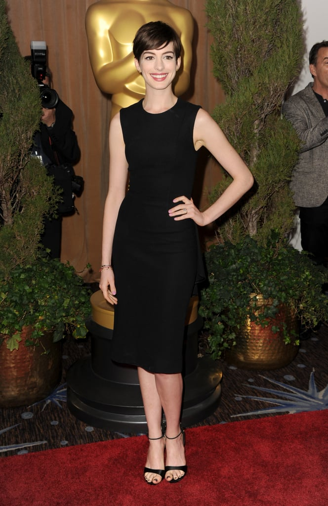 Anne Hathaway kept it classic and ultrasleek in a body-skimming LBD by The Row and ankle-strap heels.