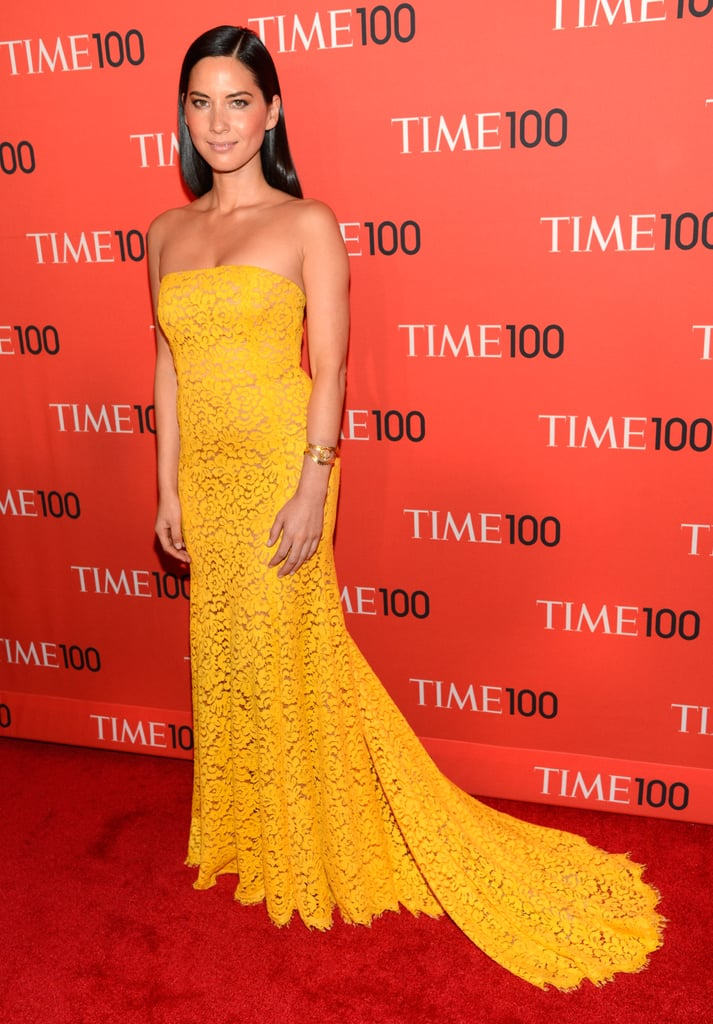 Olivia Munn supplied a burst of sunshine on the Time 100 red carpet, wearing a canary-yellow lace Michael Kors gown from the designer's Spring '13 collection. Aside from the gold cuff and a Smythson box cluth (not pictured), Munn kept things simple, letting the bright hue and dramatic train of the dress speak for themselves.