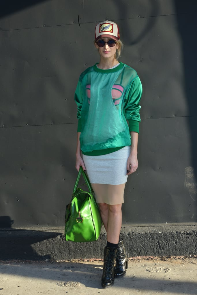 Sporty with high-impact details, thanks to a bold emerald palette and a sheer finish on her sweatshirt.