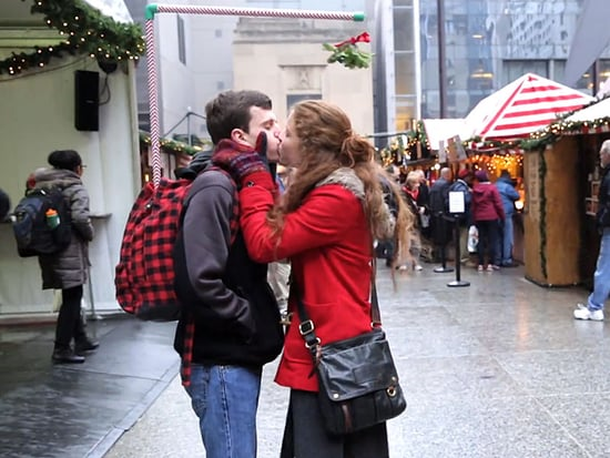 Mistletoe Contraption Snags Guy Dozens of Kisses from Strangers (VIDEO)