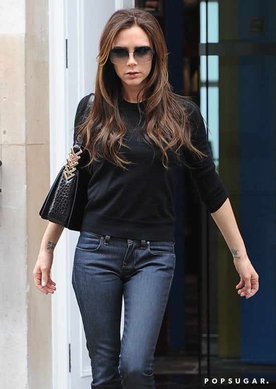 Victoria Beckham wore a black sweater with jeans for a shopping trip in London.