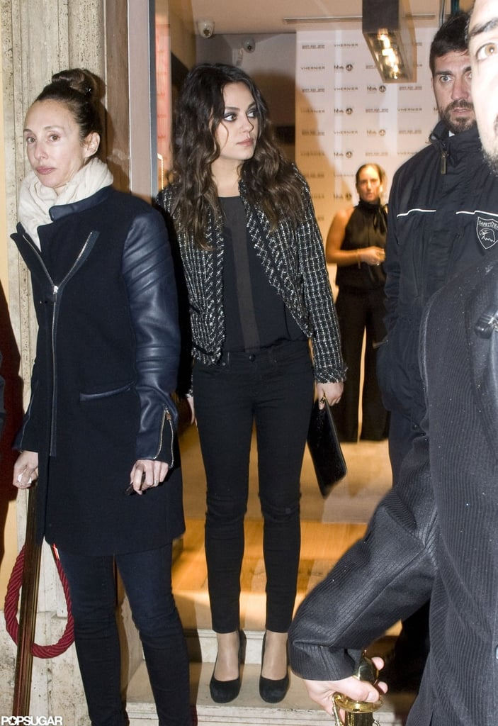 Mila Kunis carried a clutch with her.