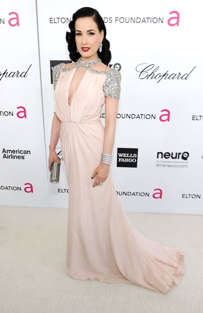 Dita Von Teese donned a blush-toned Jenny Packham gown dripping in crystal-encrusted embellishments.