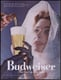 This 1957 Budweiser ad shows a woman in virginal white looking up at her male beer provider. A bit submissive, no?