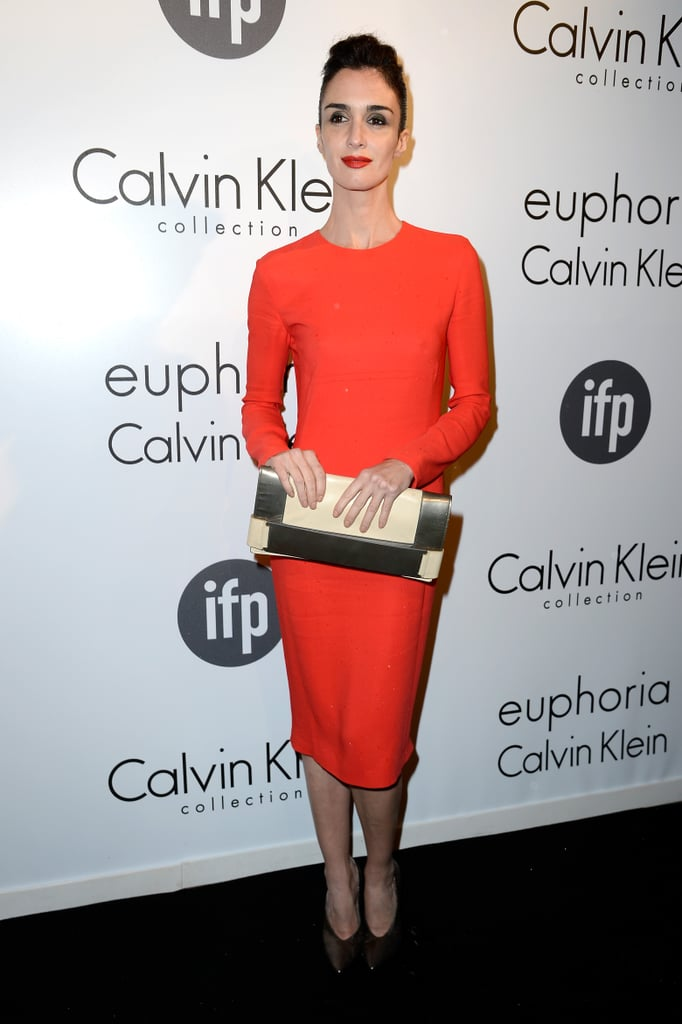 Paz Vega stood out in a red long-sleeved Calvin Klein Collection dress and a matching lip at the Women in Film event at Cannes.