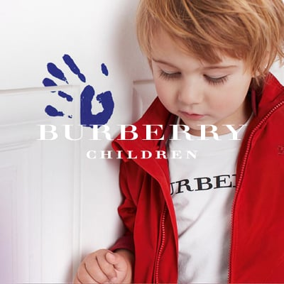 This curious little boy just expressed himself through his finger paint and his style. He is incredibly distinguished in his Burberry logo t-shirt and red nylon zip-up jacket.