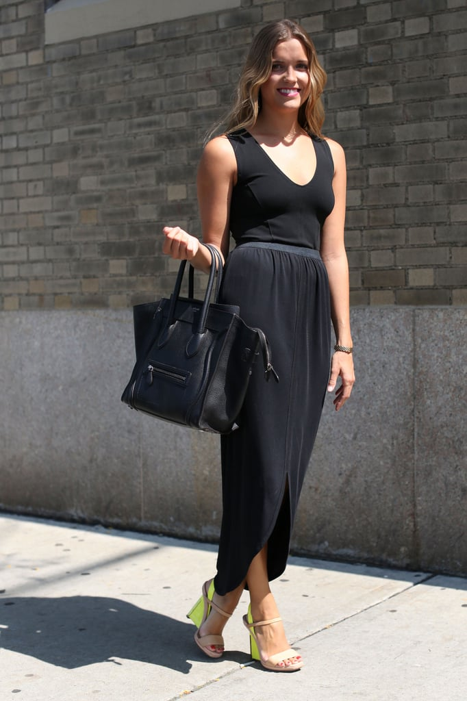 A pared-down all-black look got a jolt of added interest via the accessory must have, a Celine luggage tote, and neoprene, colorblocked wedges.
