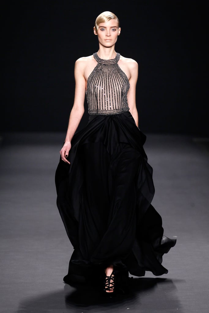 The halter-style neckline and sheer beaded bodice of this Naeem Khan Fall 2013 gown is just striking; we'd love to see it worn to the Oscars by Naomi Watts.