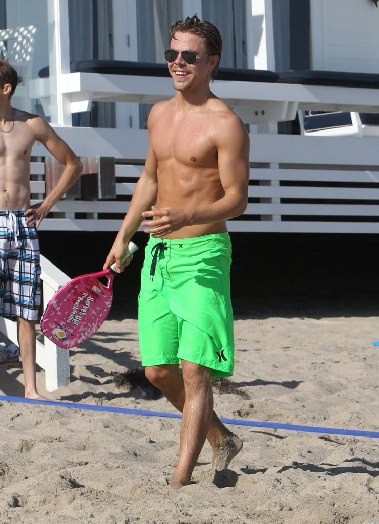 Derek Hough wore bright green trunks and a smile while on the beach in Malibu in July.