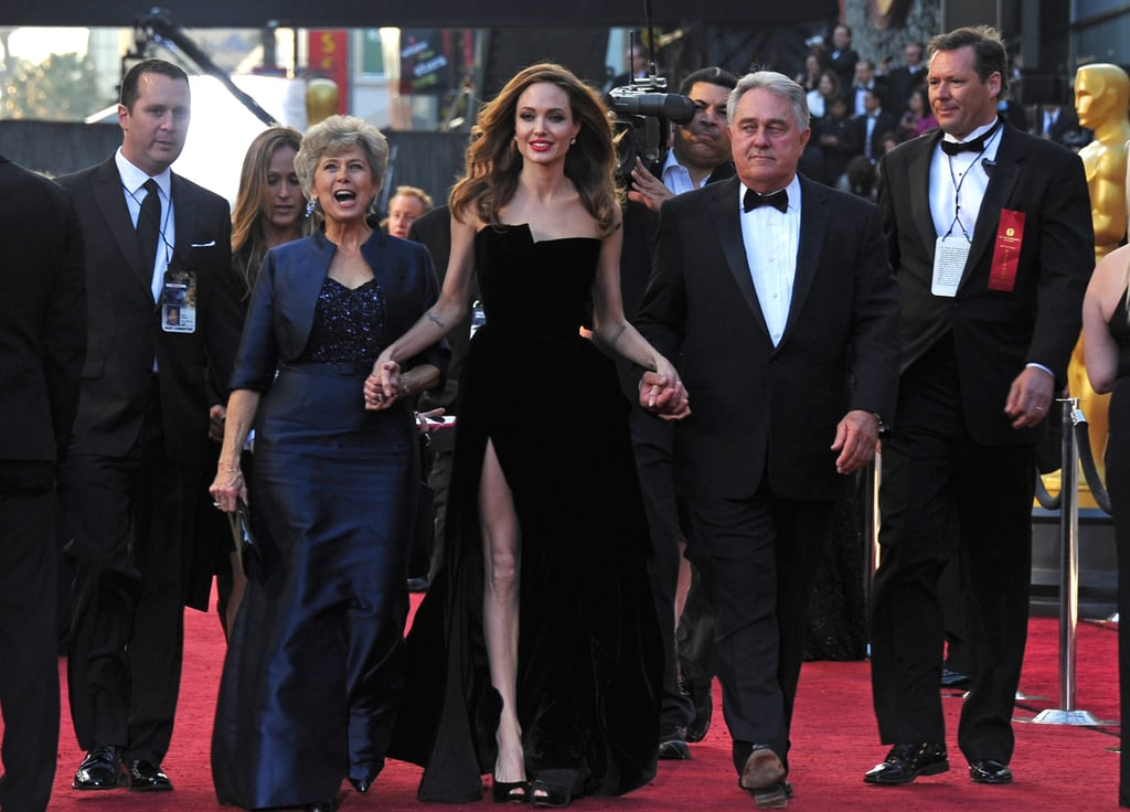 Angelina Jolie held hands with Bill and Jane Pitt.