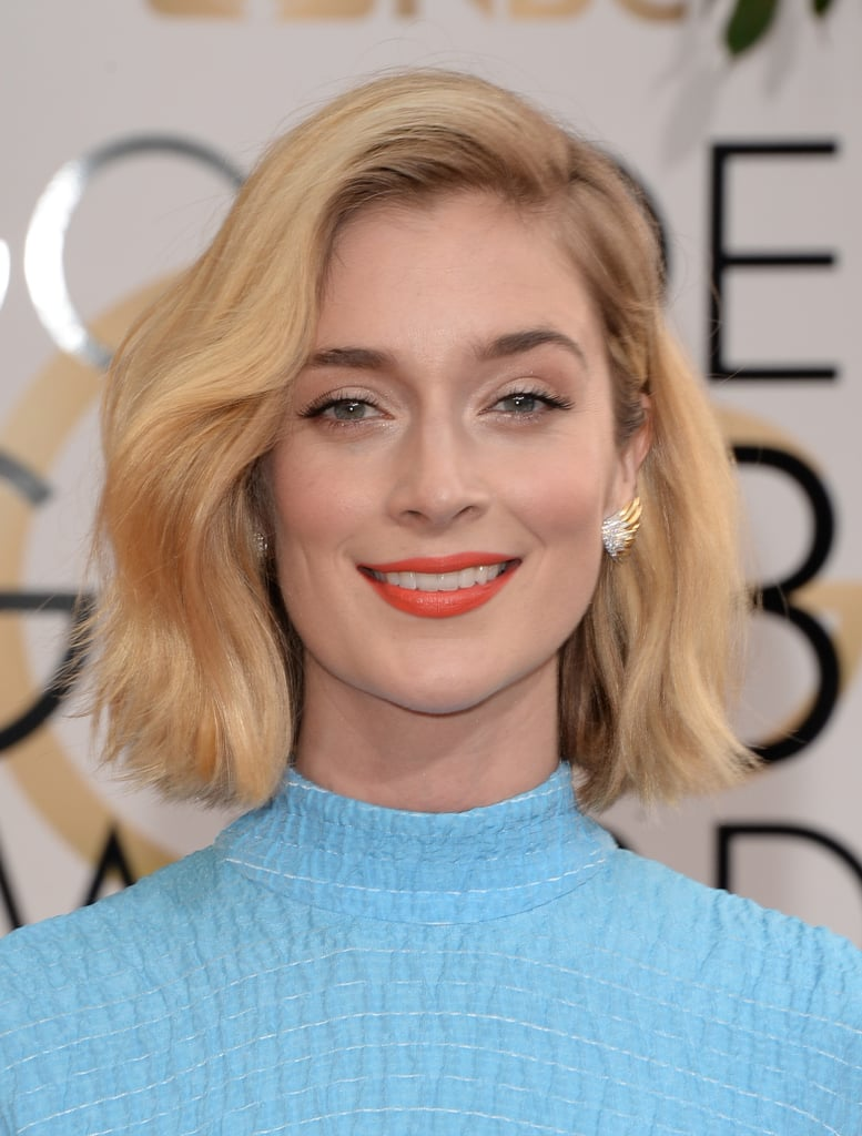 Masters of Sex leading lady Caitlin Fitzgerald channeled her character's retro glamour with deep-parted beach waves and a vibrant orange lipstick.