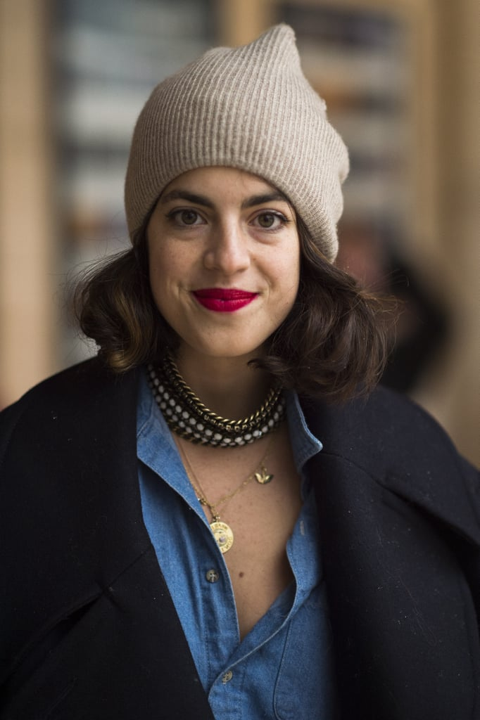 Leandra Medine, aka the Man Repeller, showed off her more classic side with a pop of red on her lips and bouncy waves. Source: Le 21ème | Adam Katz Sinding