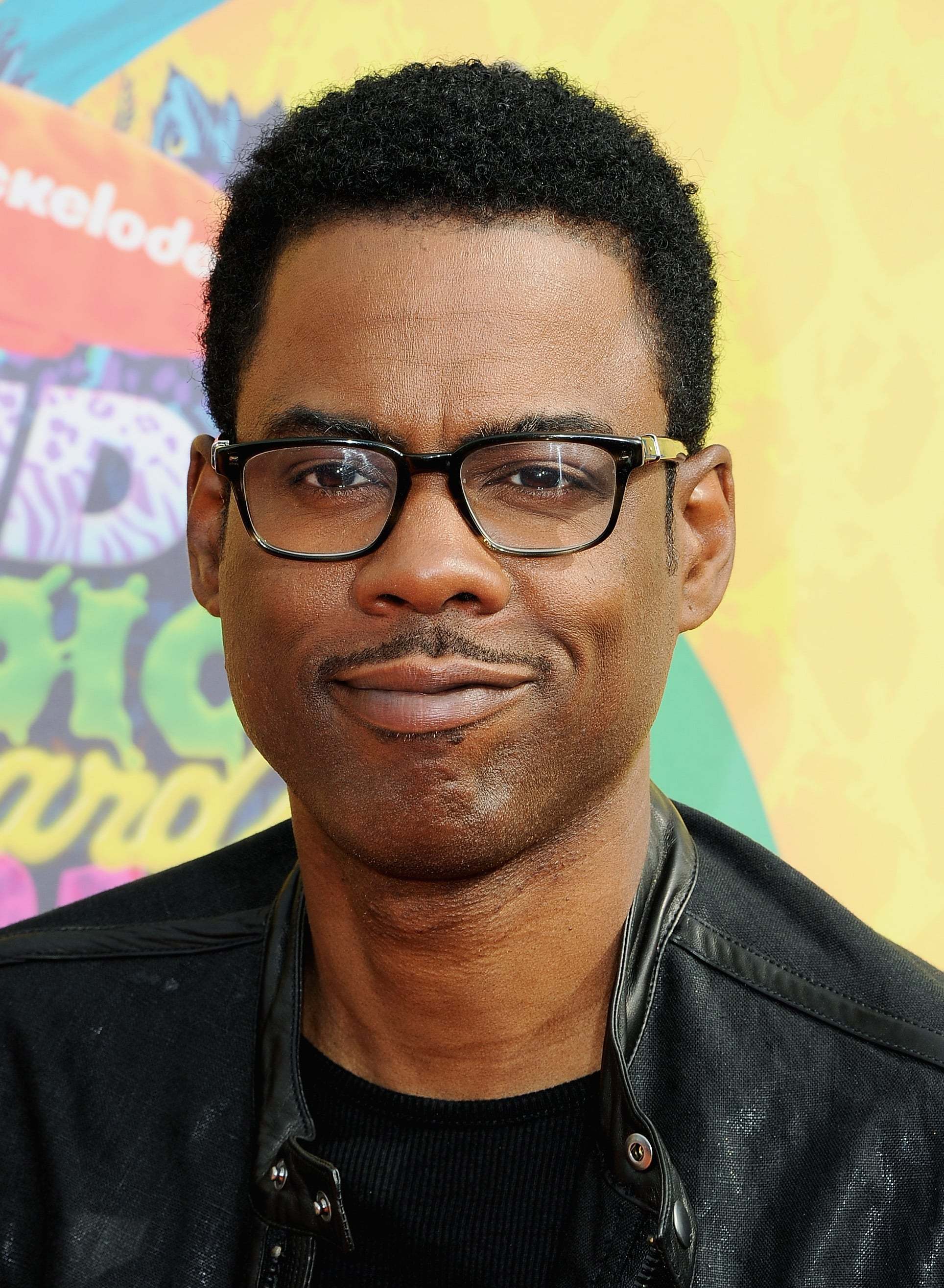 Funnyman Chris Rock wore a black leather jacket.