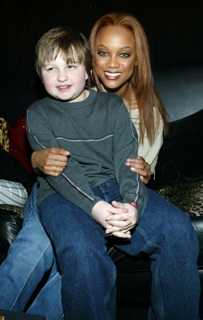 Angus takes a seat on Tyra Banks' lap at the CBS/UPN Super Bowl XXXVIII 2004 Winter Press Tour Party in January 2004.