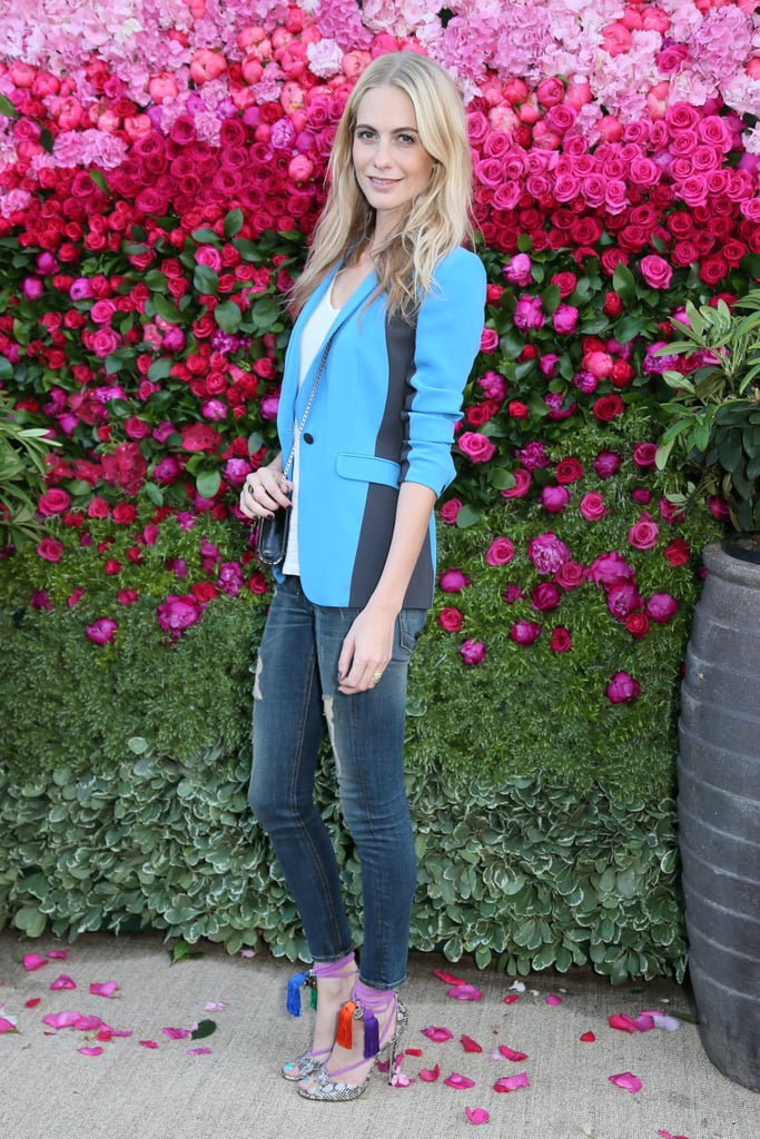 Showing off her brand of casual polish, Poppy outfitted denim with eclectic heels and a colored blazer for a Jimmy Choo dinner in London.
