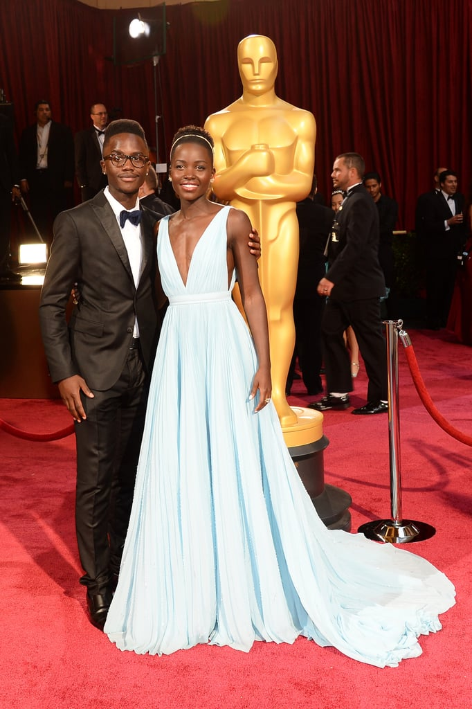 Lupita Nyong'o's younger brother, Peter, was on hand to see his sister take home the Oscar for best supporting actress — he also got to take part in a pretty epic celebrity selfie!