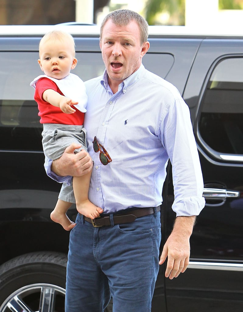 Guy Ritchie's Pregnant Fiancée Shows Off Her Ring During a Family Airport Trip