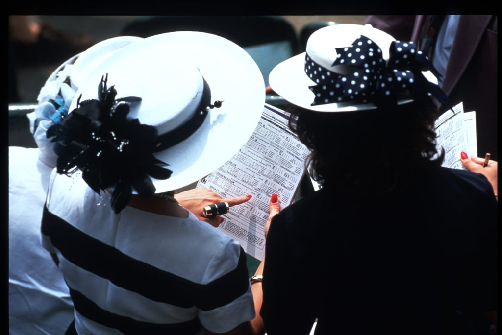 Women looked at racing tip sheets on May 6, 1995.