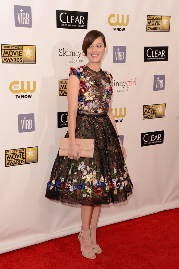 Marion Cotillard smiled in a Zuhair Murad gown on the red carpet.
