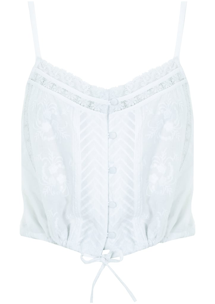 A light and breezy white lace tie-front top from the Topshop Festival Collection for Summer 2013, inspired by Kate Bosworth.