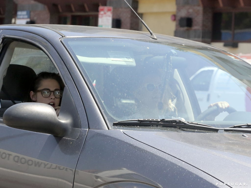Kristen Stewart rode in the car with her window down.