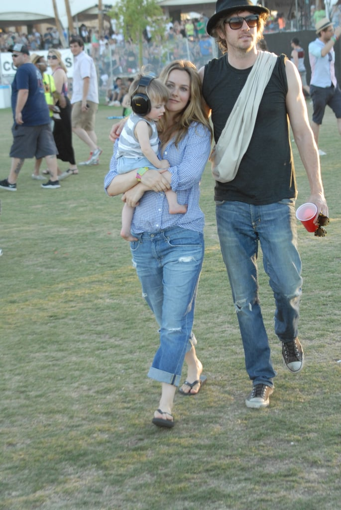 Alica Silverstone, with beau and baby, looked effortless in double denim.