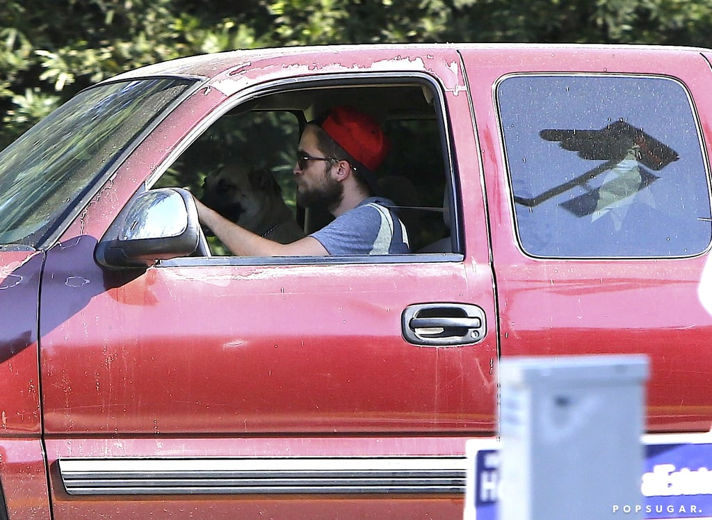 Robert Pattinson drove out of Kristen Stewart's gated community.